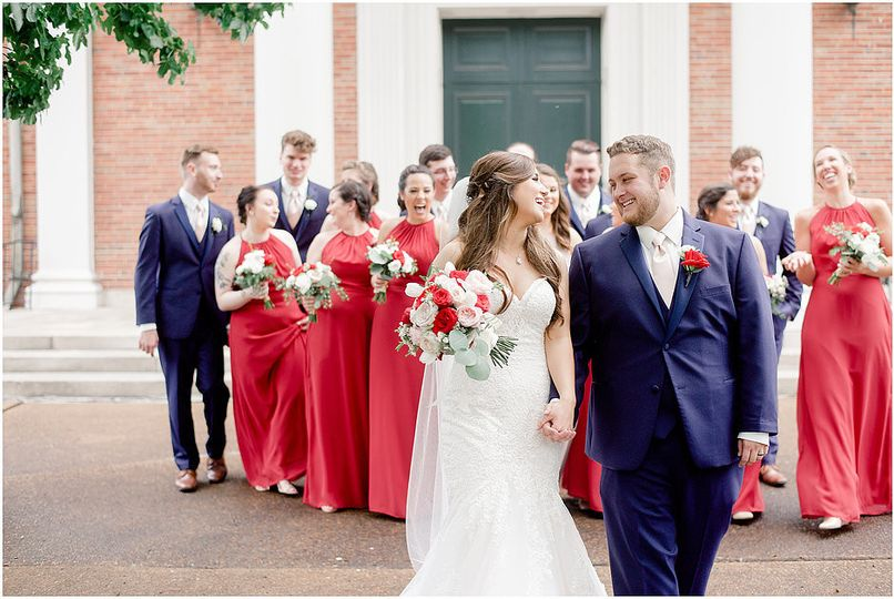 Newlyweds with bridesmaids and groomsmen