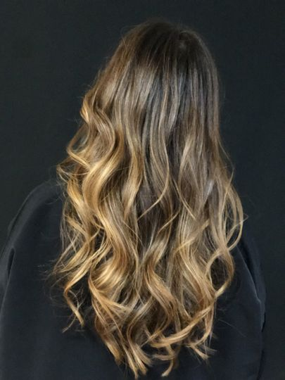 Long blow out with curls.