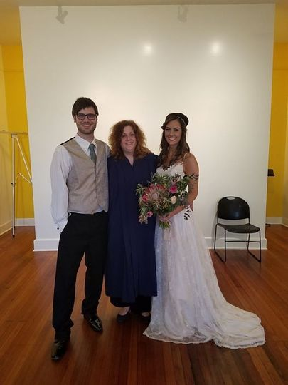 The couple with their officiant