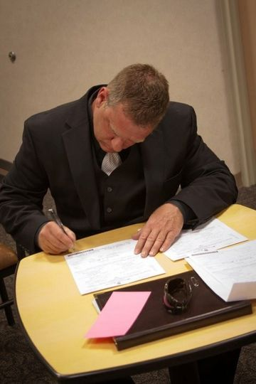 Kenneth Kibby signing marriage pages