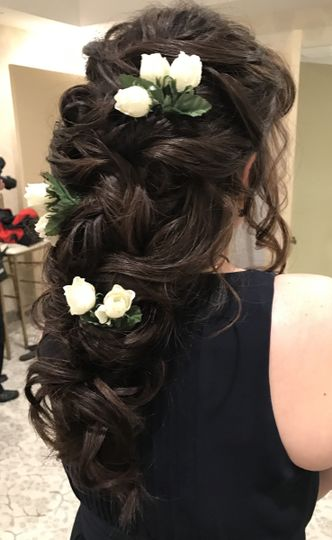 A very romantic boho type hair style for this free spirited bridesmaid.
