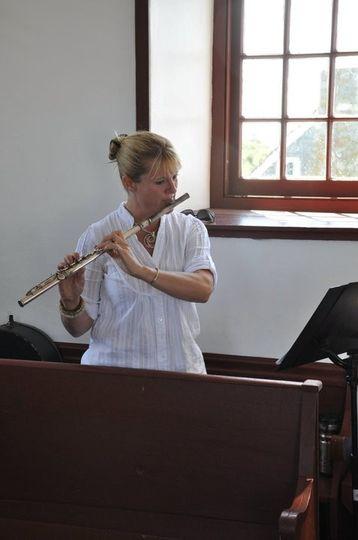Jen on flute, keyboard, and vocals