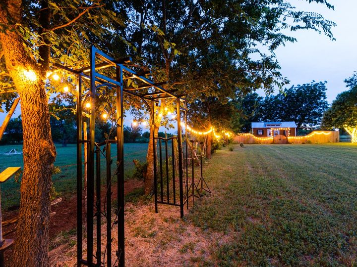 Tmx Arch To Cottage From Left 070319 51 1052821 1562208546 San Marcos, TX wedding venue
