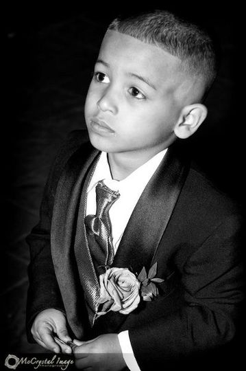 Ring-bearer intent on the wedding ceremony.