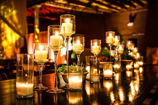 Tmx 1414089406459 Stemmed Vases With Small Pillar Candles Metairie wedding eventproduction