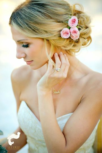 Updo with pink flowers