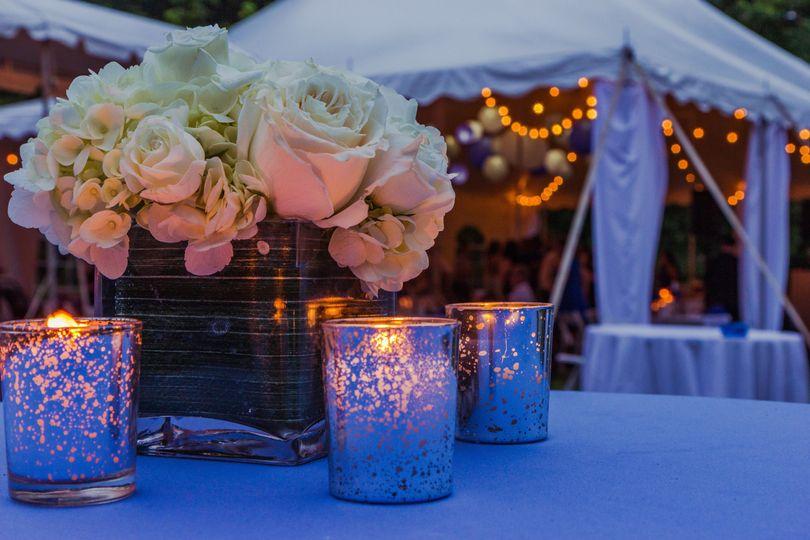 Candlelit setup and floral centerpiece