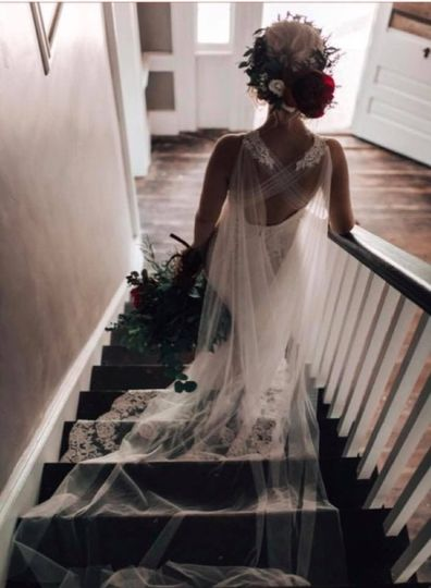 Bride's dress flowing on the stairs