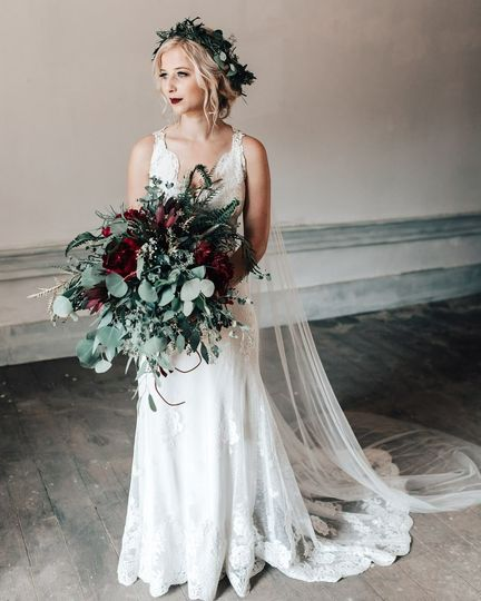 Bridal gown, bouquet, and flower crown