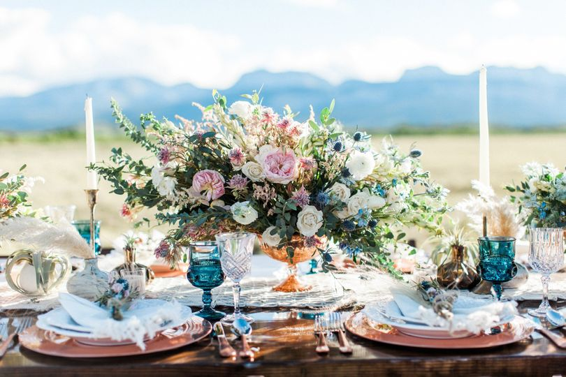Sweetheart table with floral and candle centerpiece