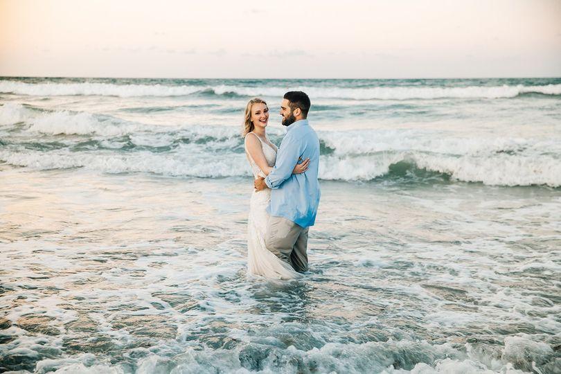 bride groom playing in ocean melbourne florida 51 1002921