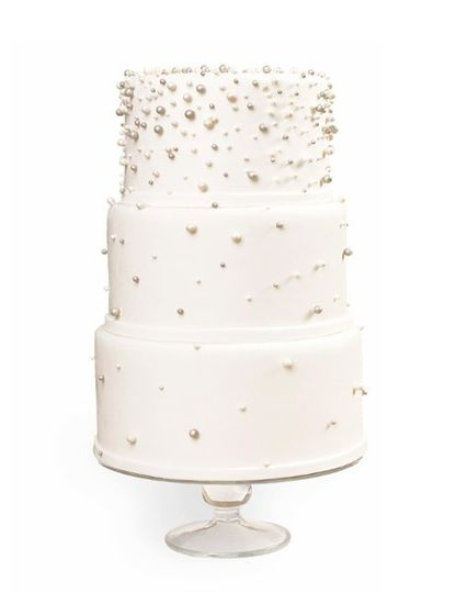 Cake covered in white fondant with edible sugar pearls