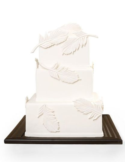 Square cake covered in white fondant and decorated with sugar feathers created for Modern Bride...