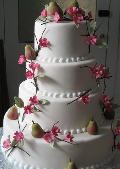 Cake covered in white fondant and decorated with handmade gumpaste cherry blossoms and marzipan...