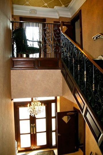 Beautiful entryway and staircase leading to the Diamond Room (elevator access also available).