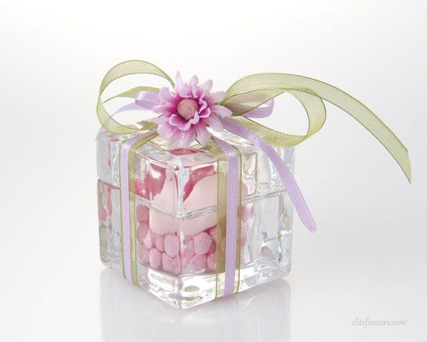 Young Glass-made ice cube filled with two different varieties of confetti candies, hand made small...