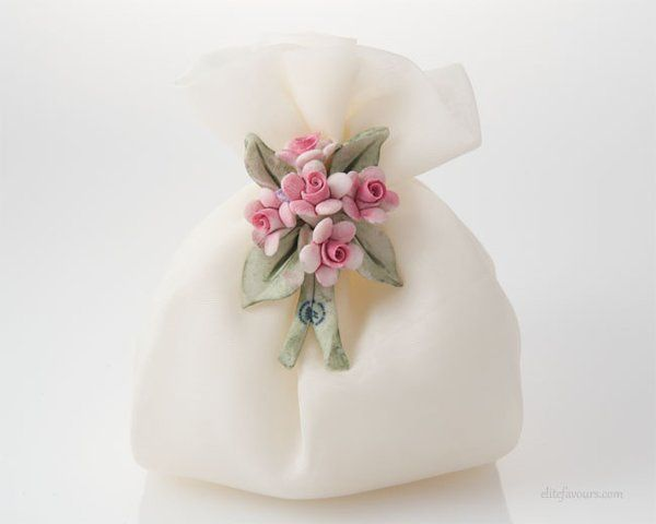 Charming Finest quality organza sachet filled with almond confetti candies and soft filling, hand...