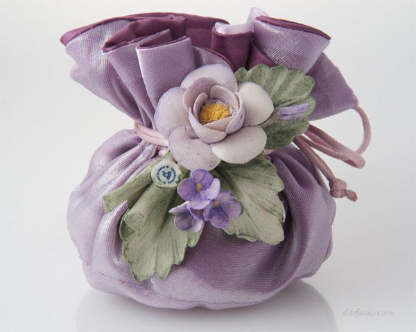 Artistic Double layer silk sachet filled with almond confetti candies and soft filling, hand made...