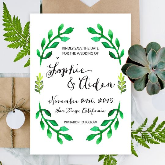 "Our Sophie, ""Save The Date"" features watercolor botanical accents and a calligraphy style font."