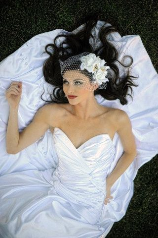 Bride lying down on the grass