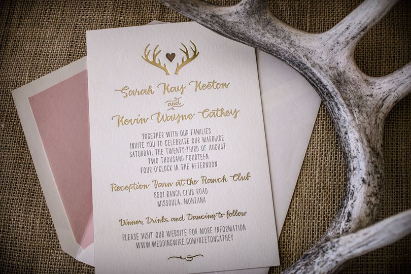 Gold foil-stamped and 1-color letterpress invitation with foil edging, custom antler/heart logo and...