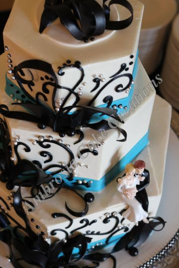 White and blue wedding cake with chocolate detailing
