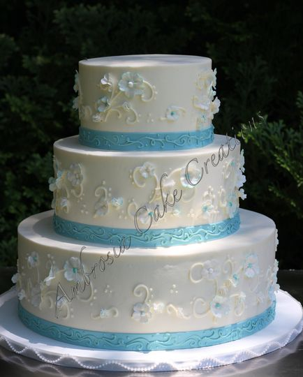 3-tier cake with blue ribbons