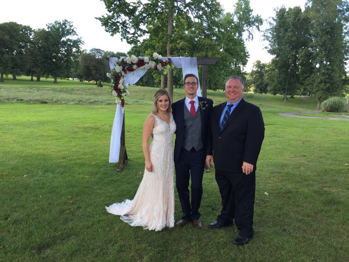 Newlyweds and their officiant