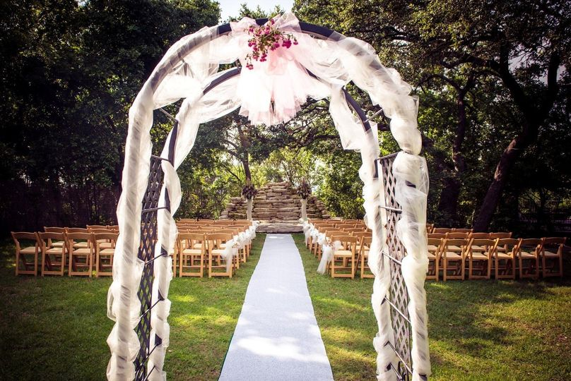 decorated arch ceremony on lawn cropped