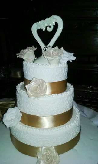 Three Tiered Buttercream with Sugar Paste Flowers.