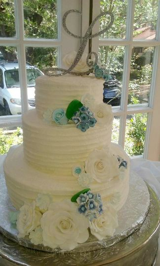 Three Tiered Buttercream Rustic Wedding Cake, with Sugar Paste Flowers.