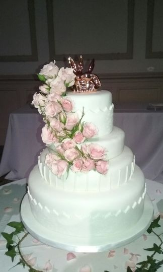 Four Tiered Marshmallow Fondant Wedding Cake, with Fresh Flowers.