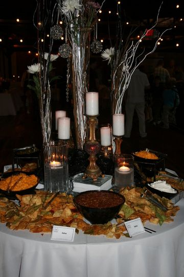 Long white twigs, twinkle lights and pillars add a touch of elegance to this table scape!