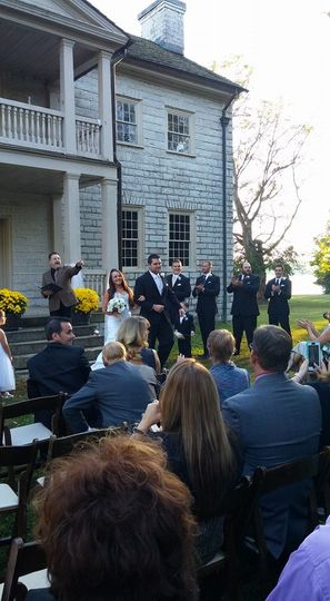 A semi formal wedding in front of a civil war mansion!  At the pronouncement - a family of deer...