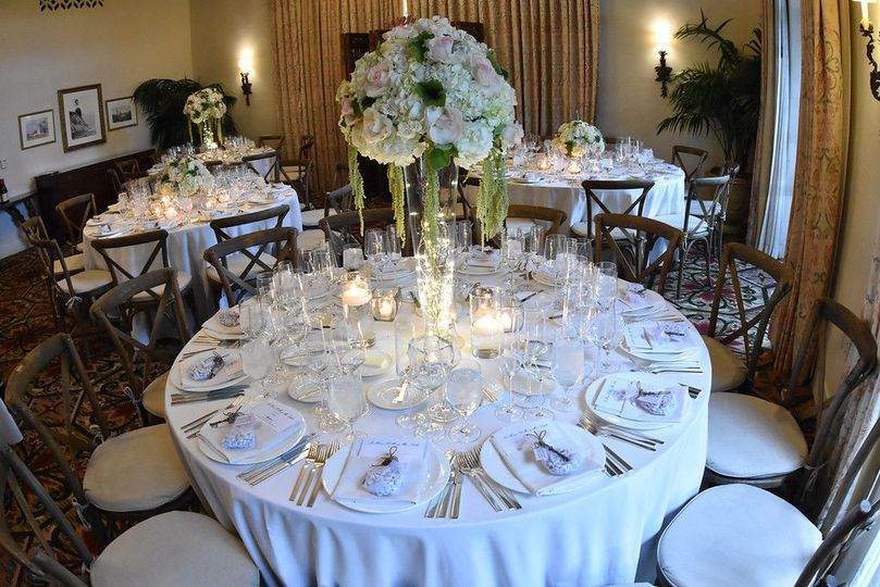 Raised centerpieces can also be used down the aisle.