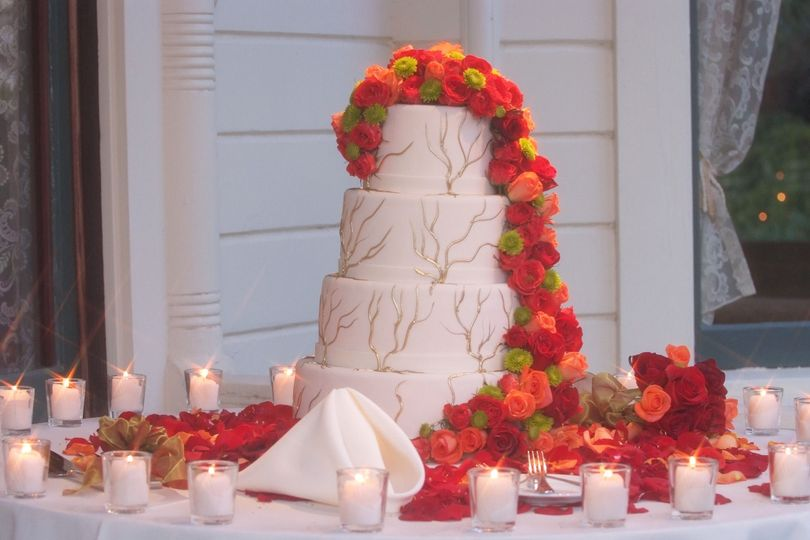 Bright cake flowers that played off the barn wedding.
