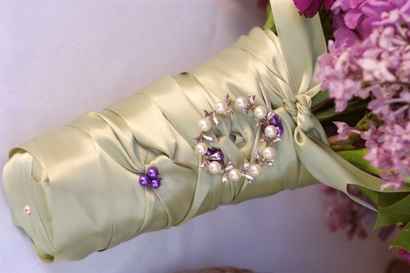 Details on a wedding bouquet. Bride's Grandmothers pin.