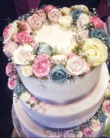 Hand piped rose wedding cake
