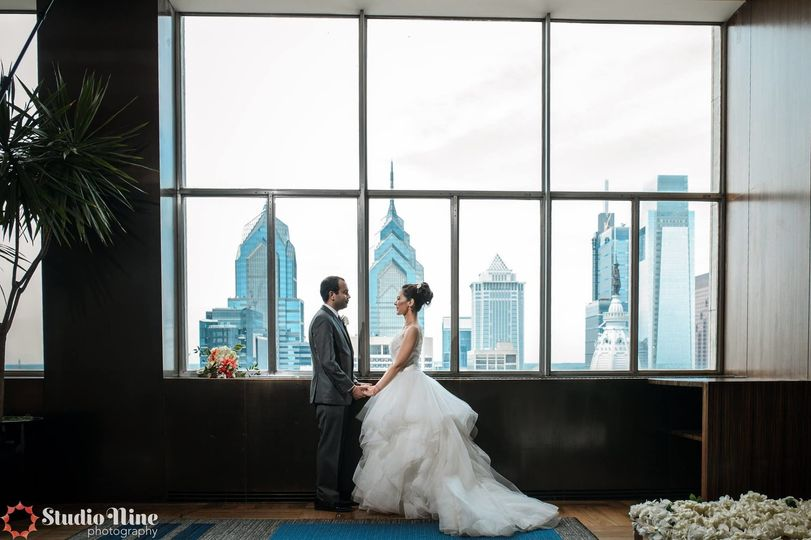 Newlyweds and the view of the city skyline