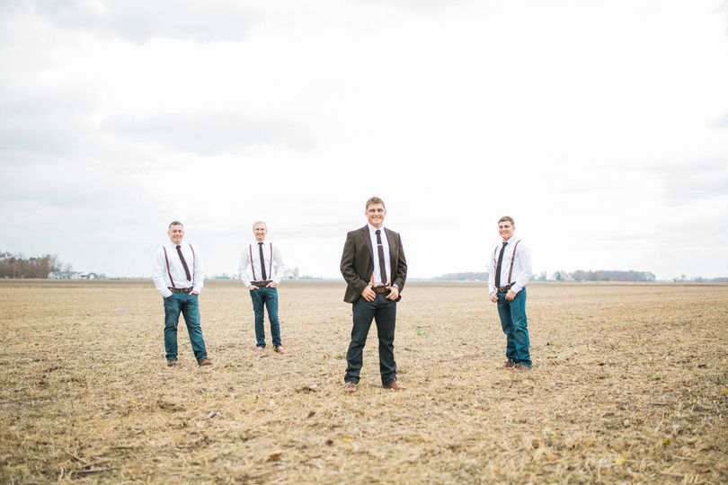 Groom and groomsmen in the field
