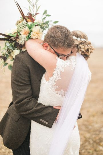 "Couples embrace after saying ""I do"""