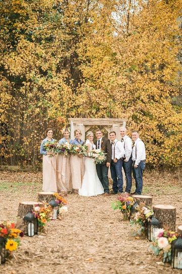 Wedding party in view of autumn trees
