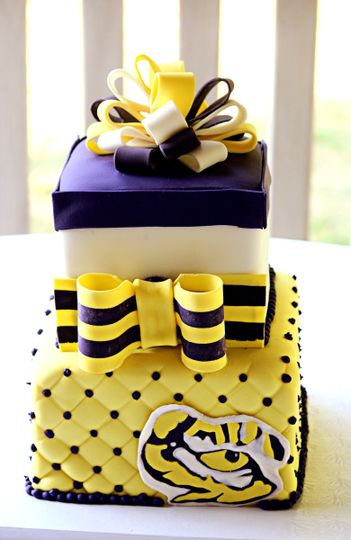 LSU Groom's Cake. 2 tiers with quilting, striped ribbon, gift bow topper, and fondant tiger eye.