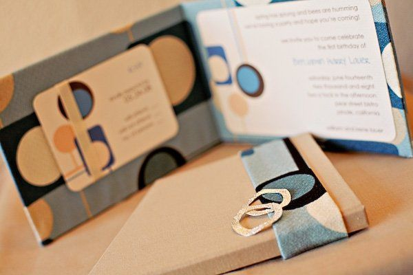 A canvas book ushers in the first birthday party for a very special little boy. The invite is...