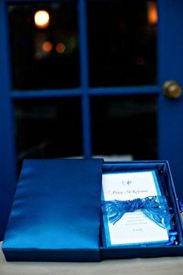 A rich cobalt blue silk drawer encases a matching invitation for a black tie Atlantic affair. The...