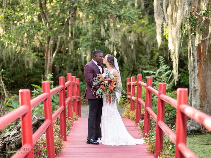 Tmx Bride And Groom Kissing On The Red Bridge Magnolia Plantation Charleston 2020 51 783131 160314400069464 Charleston, SC wedding catering