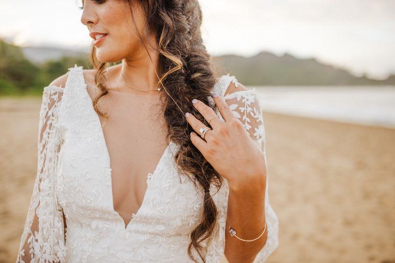 Close up of attire at beach wedding
