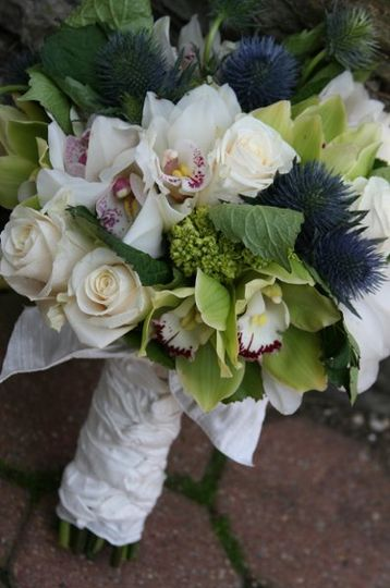 hand tied bouquet of orchids, roses and thistle