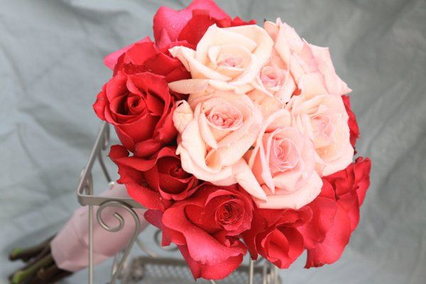 Bold pink roses complete the classic princess design of this bridal bouquet.