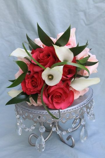 White Calla Lilies combined with pink Roses bring an elegant bouquet to life!